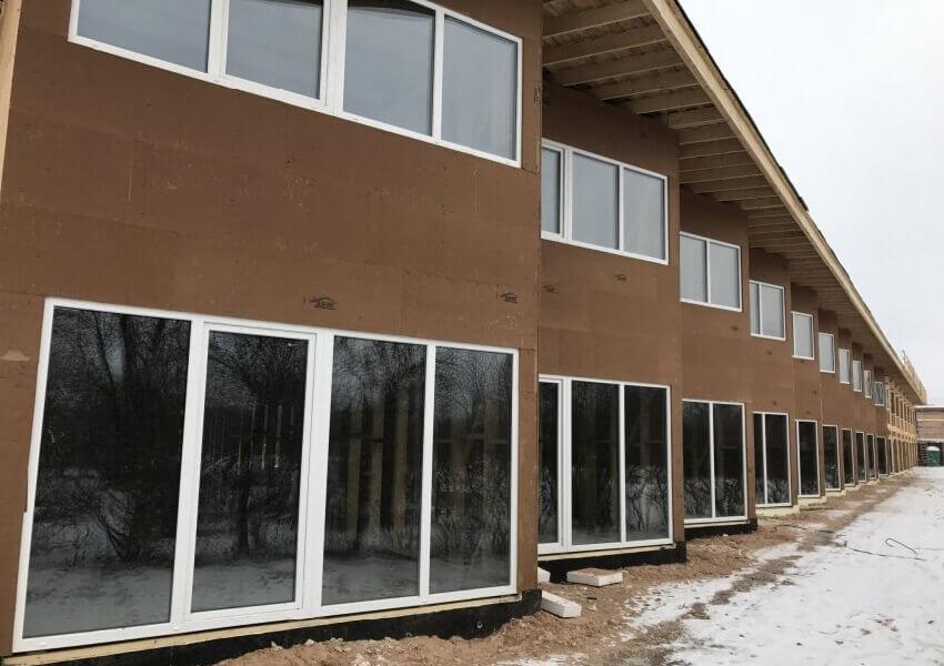 Фасад здания, утепленный древесно-волокнистыми плитами